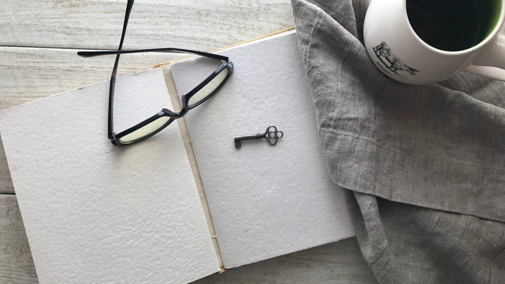 coffee, glasses, open book